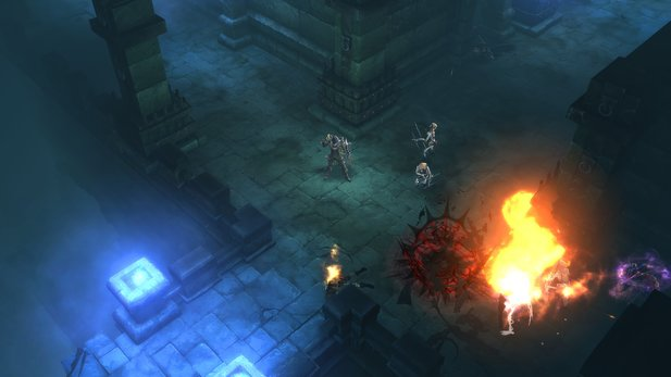 The demon hunter bombs his enemies with grenades while luring them into his spike trap at the same time.