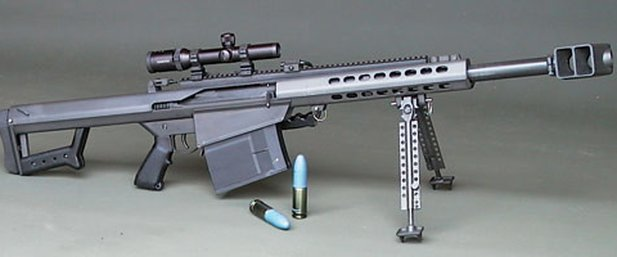 Prototype of the XM109 with associated ammunition.